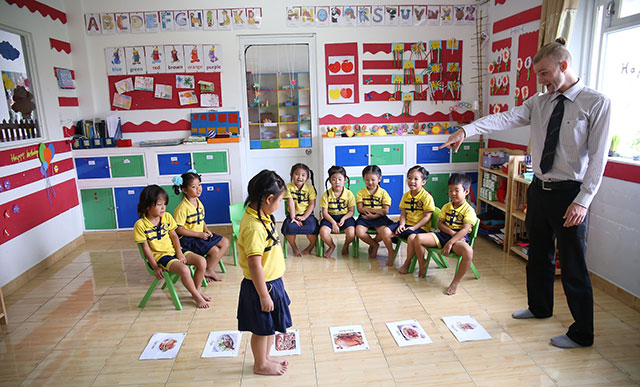 TEFL teacher teaching young children in Asia